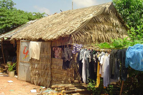 Photo of a ramshackle house with clothes hanging outside