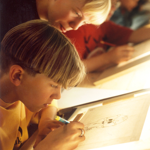 Photo of pupils at a lightbox