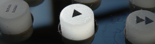 Close up of a play button on a remote control