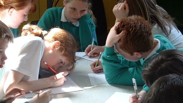 Photo of pupils working on a script