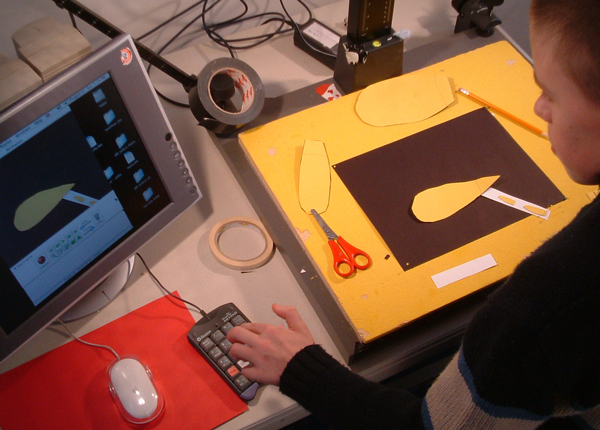 Photo of cutout animation happening on a rostrum