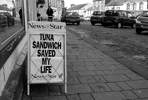 Photo of a newsagent's a frame with a headline