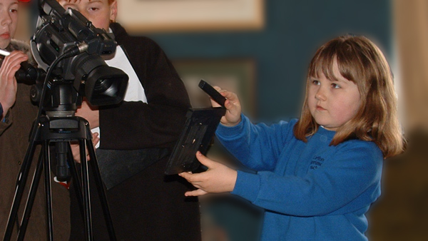 Photo of pupil usng a clapperboard
