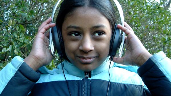 photo of a girl using headphones