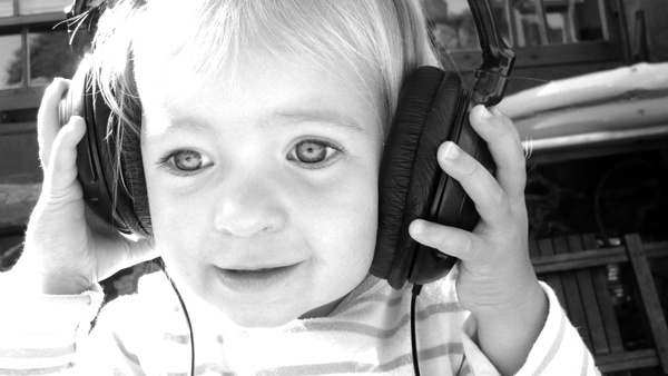 Photo of a toddler wearing headphones