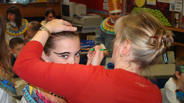 Photo of makeup and hair being done