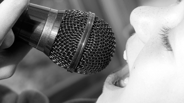 Photo of child singing into a microphone